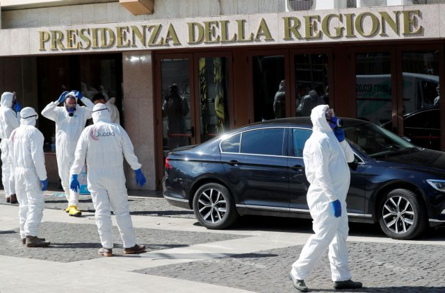 Workers dressed in protective garments prepare to sanitise a regional building as Italy seeks to contain a coronavirus outbreak in Rome, Italy March 8, 2020. REUTERS/Remo Casilli